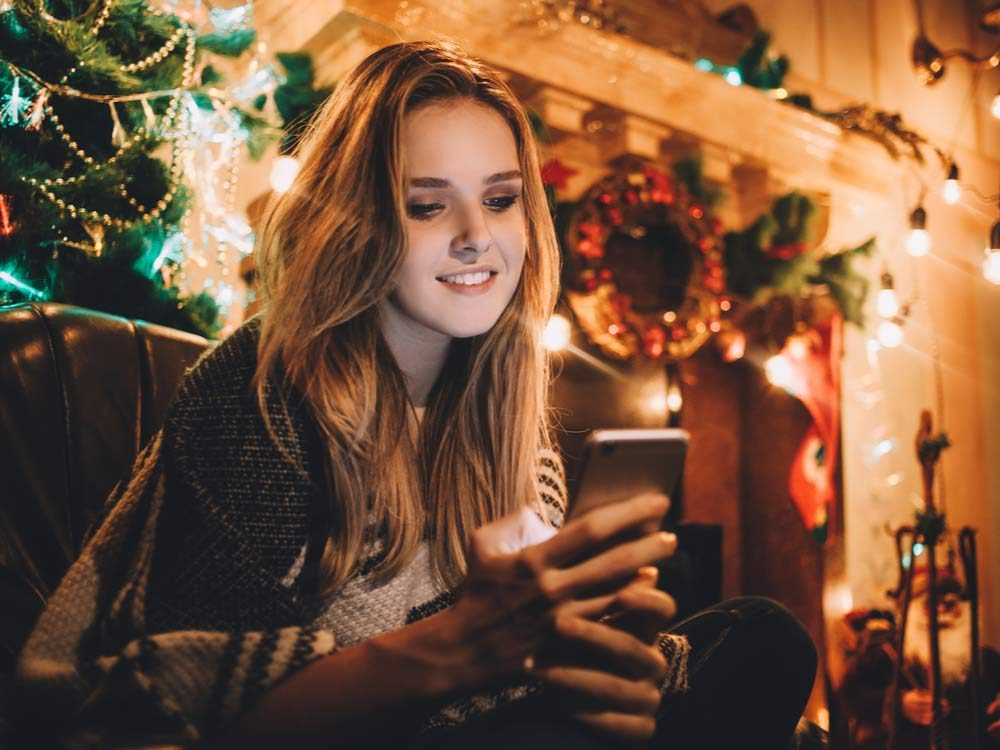 Woman on her phone during the holidays