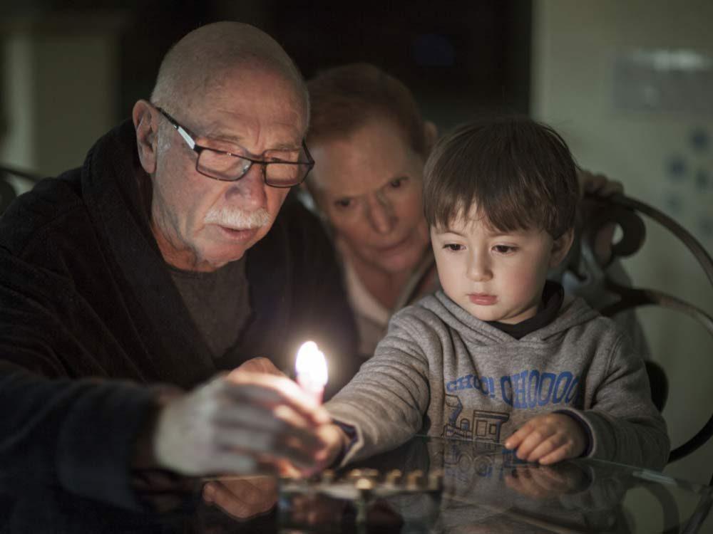 Lighting Hanukkah candle
