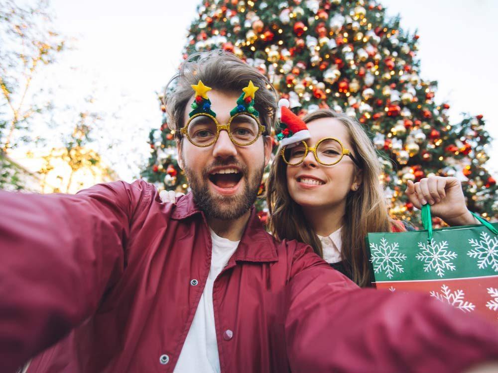 Couple having Christmas selfie