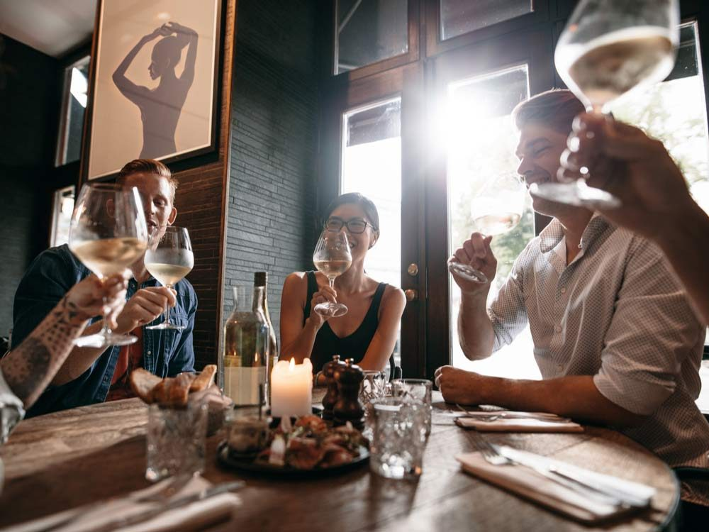 Group of friends drinking wine at restaurant