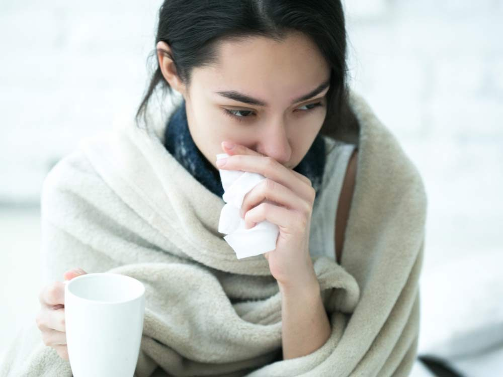 Woman with flu symptoms