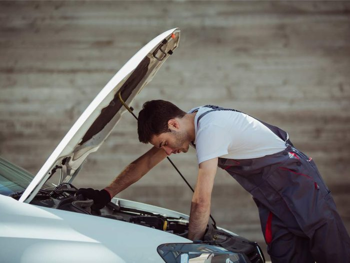 How to remove rusted bolts - man looking under car hood