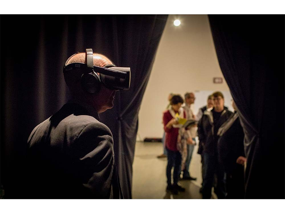 Man with virtual reality helmet