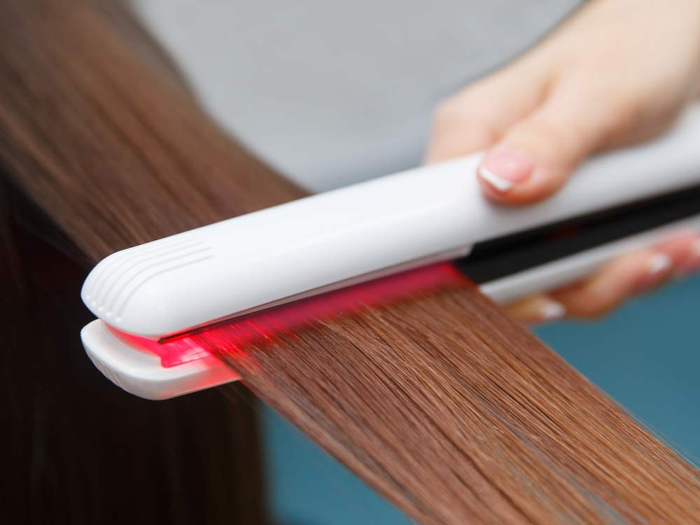 Hair straightener in use