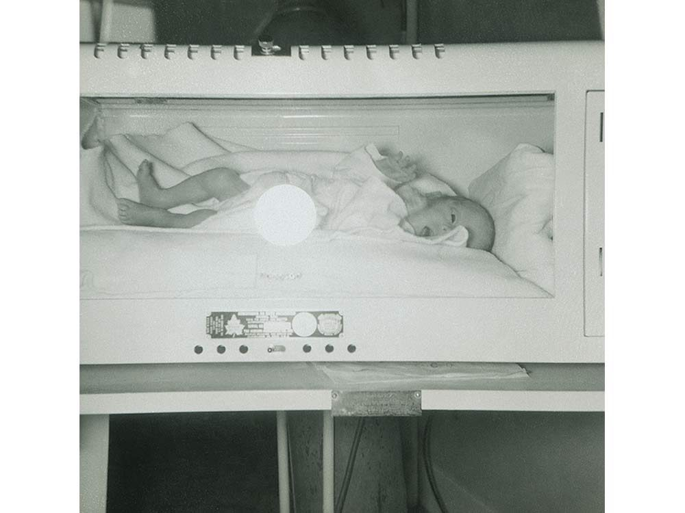 Baby Don in an incubator