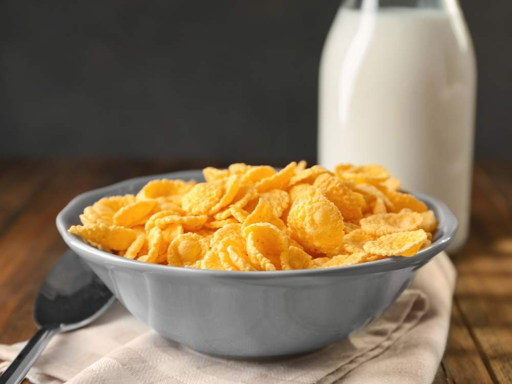 Corn flakes cereal with glass of milk