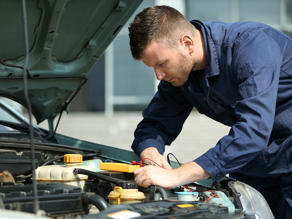 Before taking your car on a road trip, go for a tune up with a mechanic