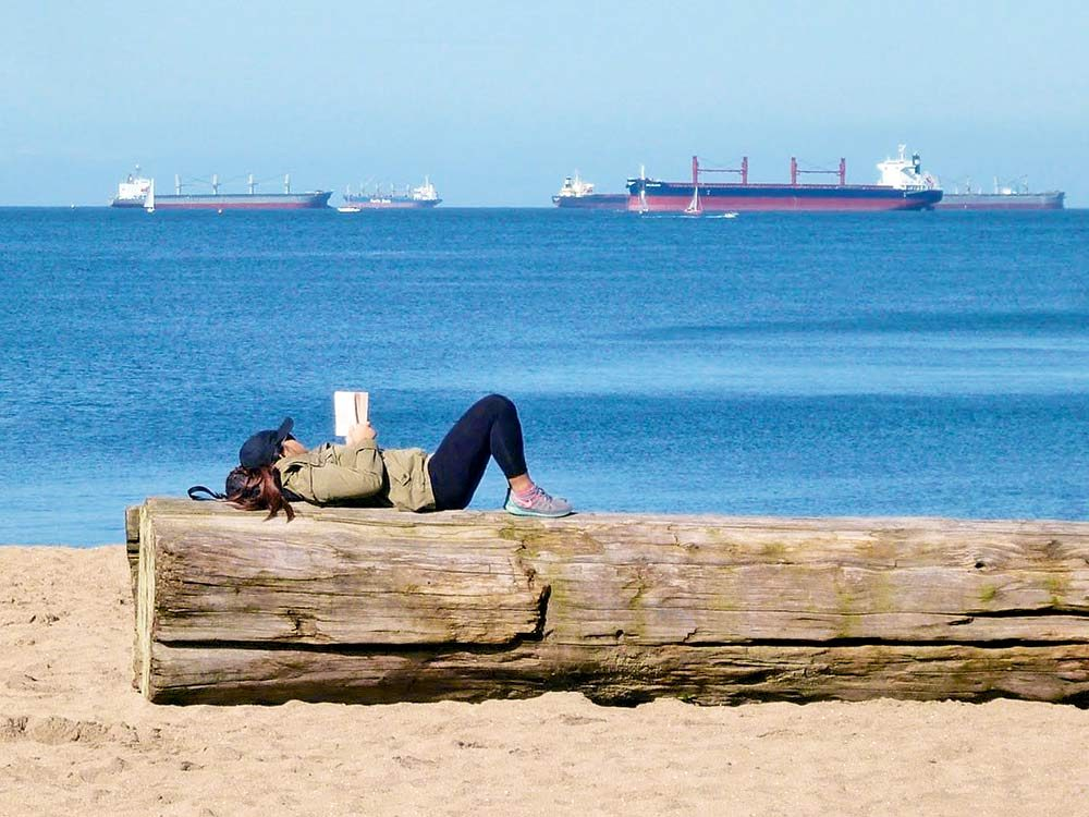 Girl reading on Vancouver waterfront