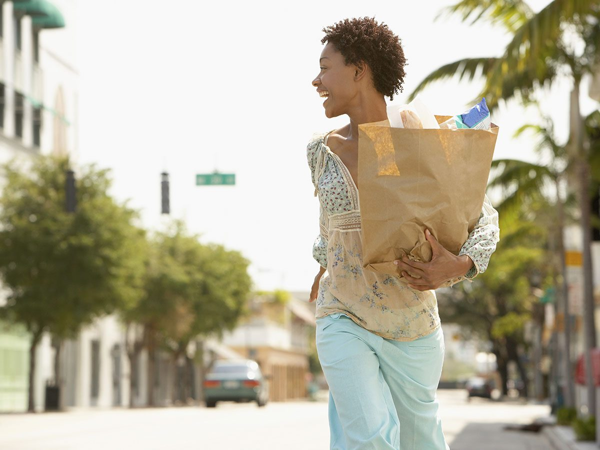 Walking 10,000 steps a day strengthens bones - walking with groceries