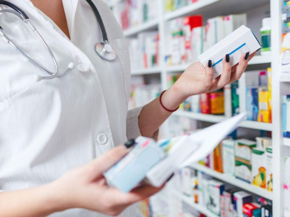 Pharmacist handling prescriptions
