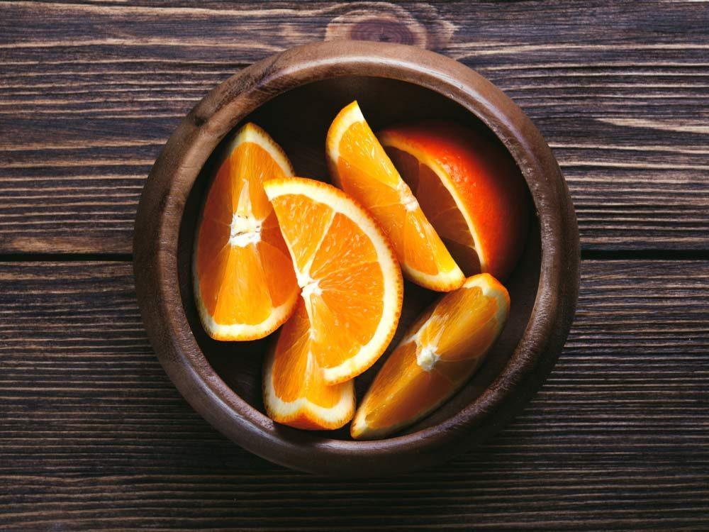 Orange slices in wooden bowl