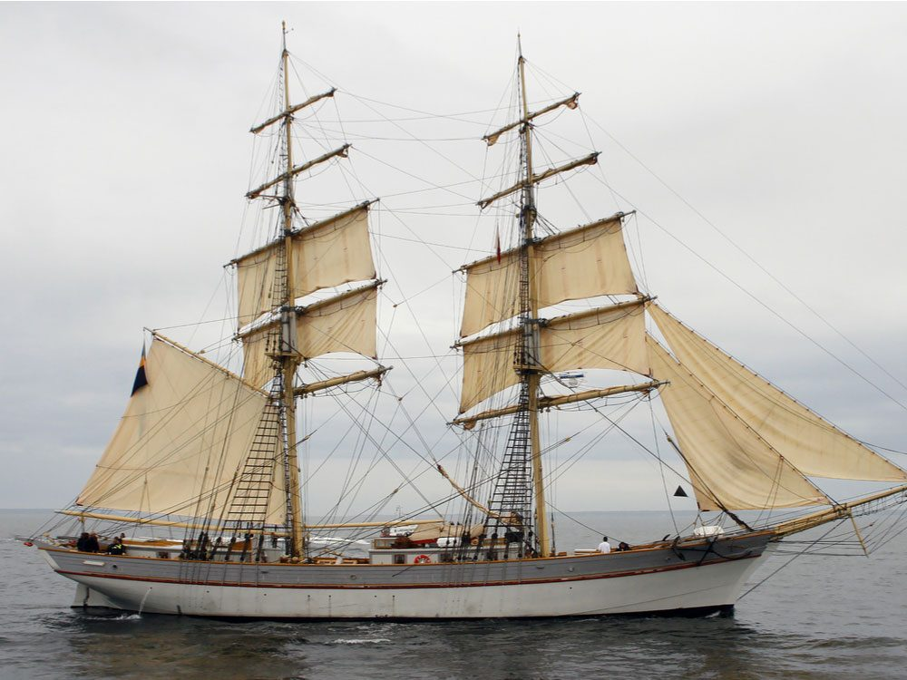 Vintage ship with sails at sea