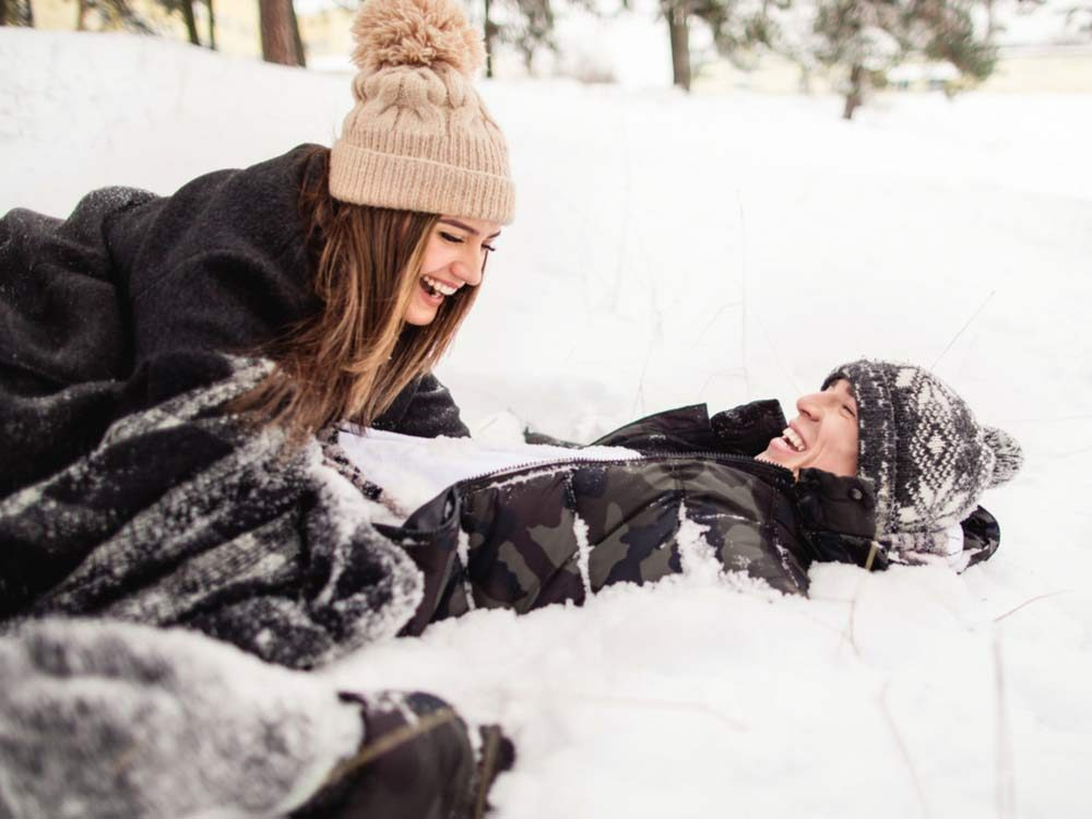 Two friends playing outside in winter