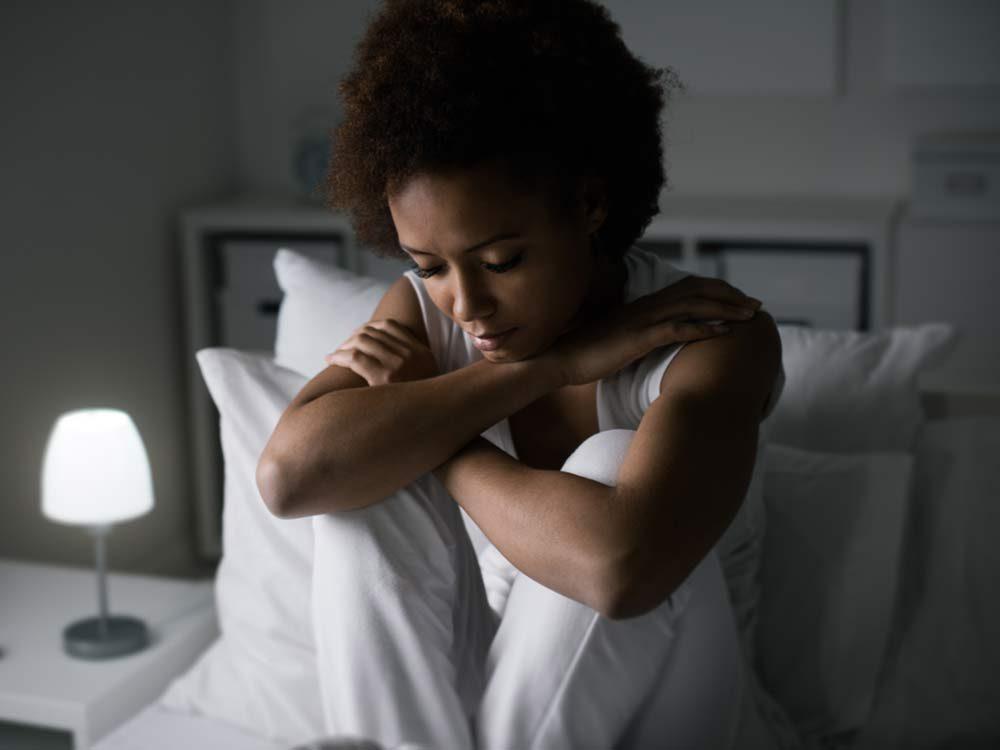 Sleepy woman sitting in bed