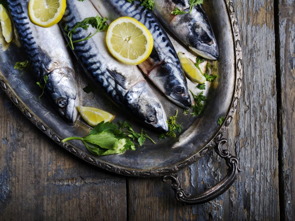 Mackerel served on silver plate with lemon