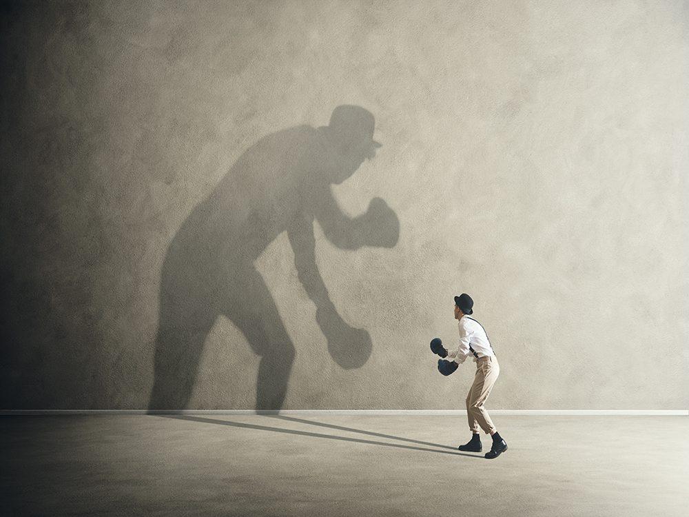 Man fighting his inner demons