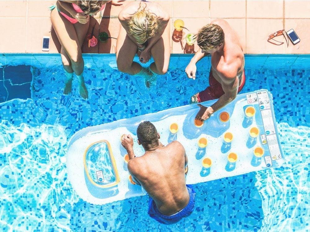 Friends enjoying drinks at swimming pool