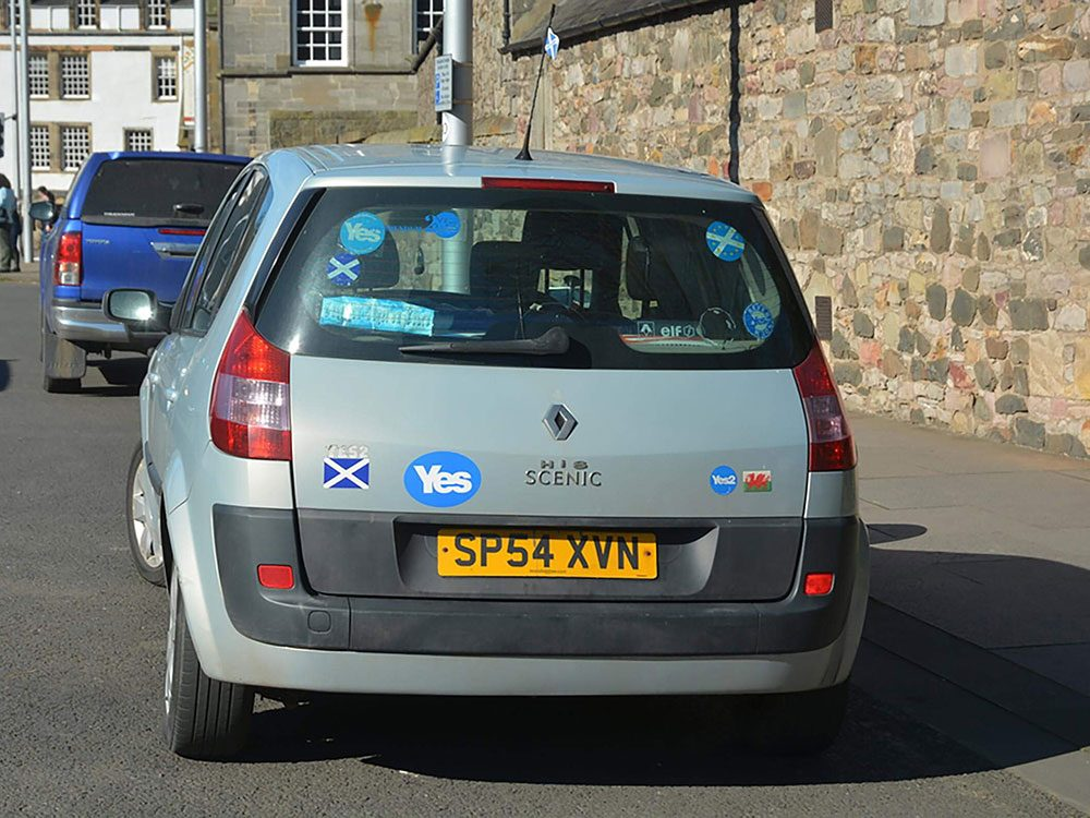 Football team stickers on car