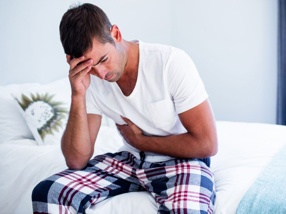 Man experiencing pain from gallstones