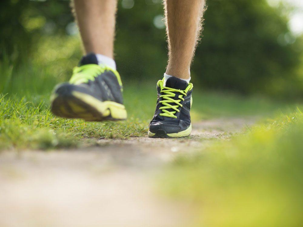 Close-up of running feet