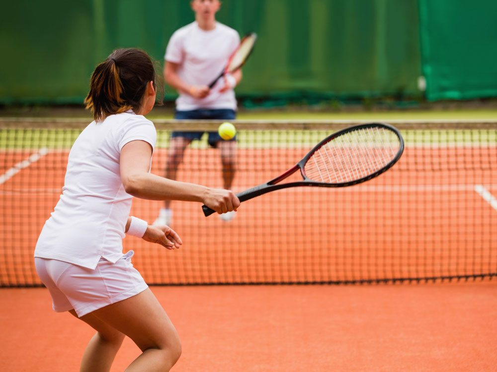 Man and woman playing tennis