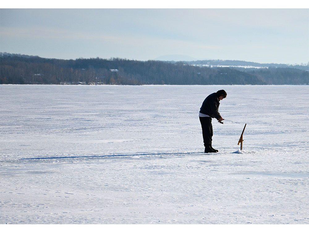Lone fisherman in Sherbrooke, Quebec
