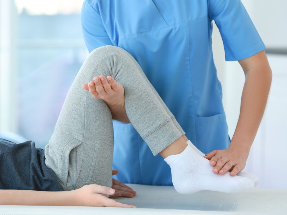 Female patient undergoing physiotherapy