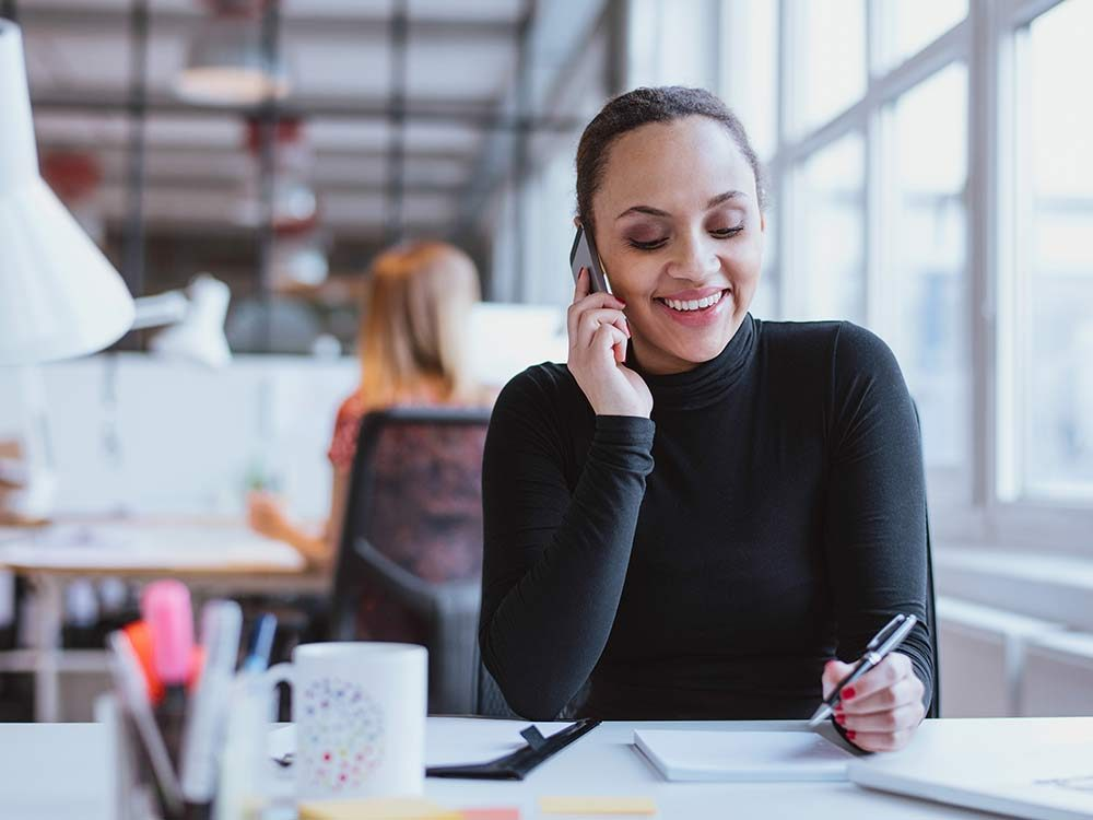 Woman talking on phone at office