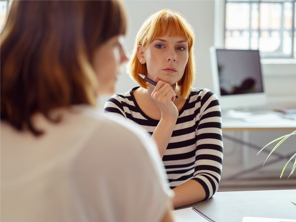 Irritated woman at office meeting