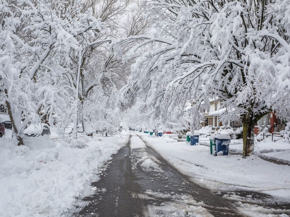 Snowy street of Buffalo, New York suburb