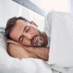 Bearded man sleeping in bed