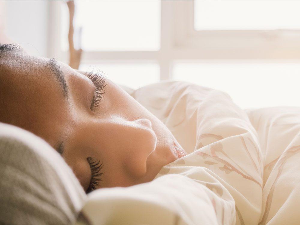 Asian woman oversleeping