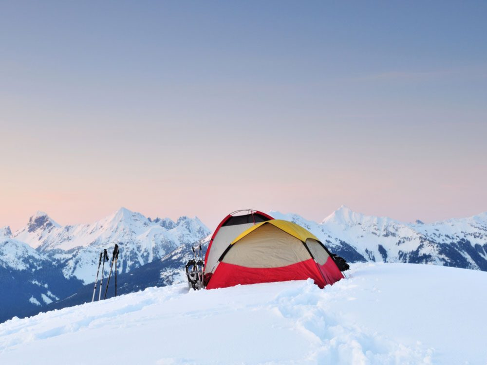 Tent on side of snowy mountain
