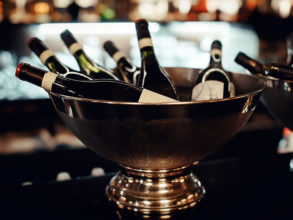Wine bottles in ice bucket