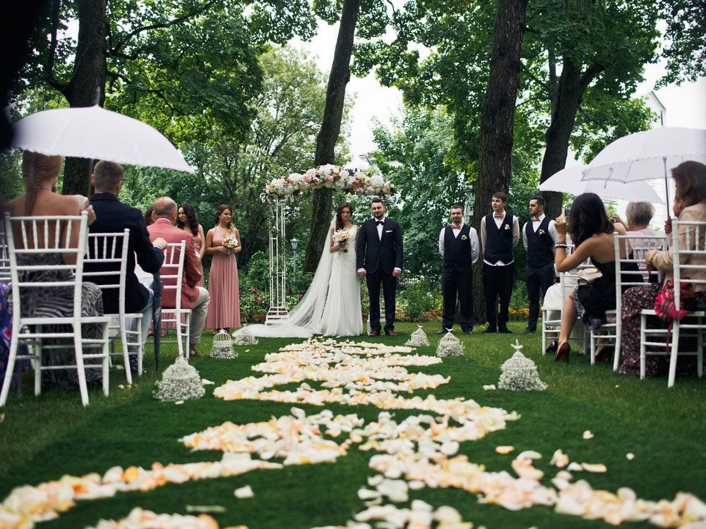 Outdoor wedding with flower petals on the ground