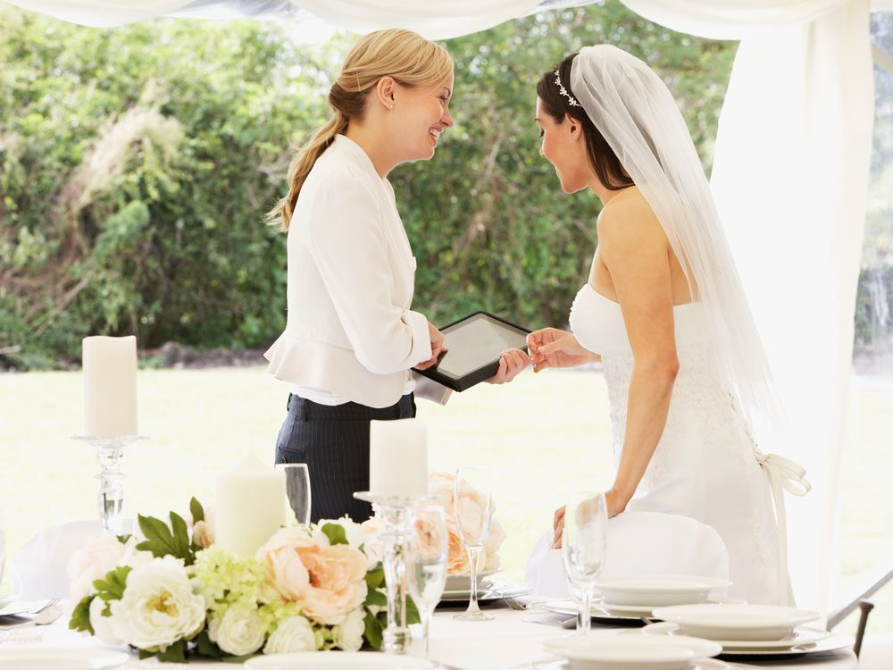 Wedding planner chatting with bride