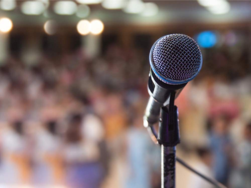 Microphone with blurred crowd background