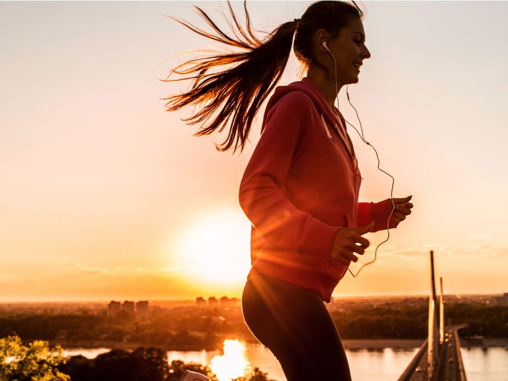 Woman listening to music as she prepares to exercise