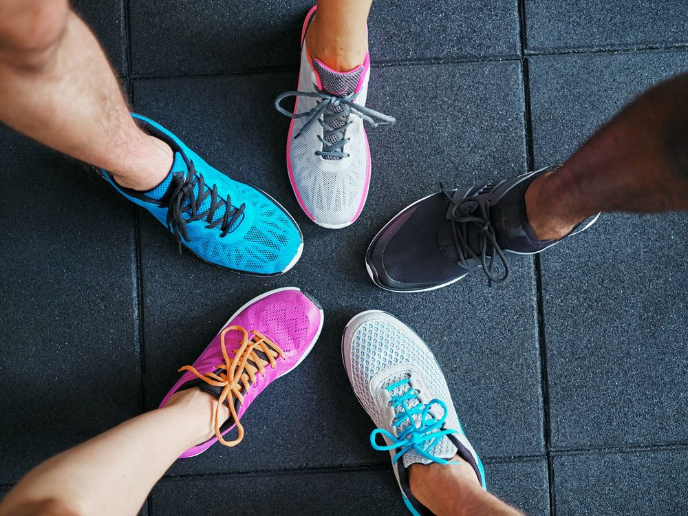 High angle of people wearing running shoes