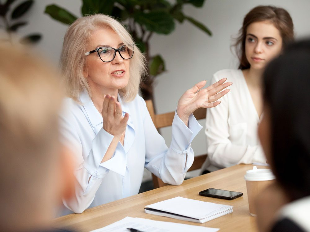 Female boss speaking at office meeting