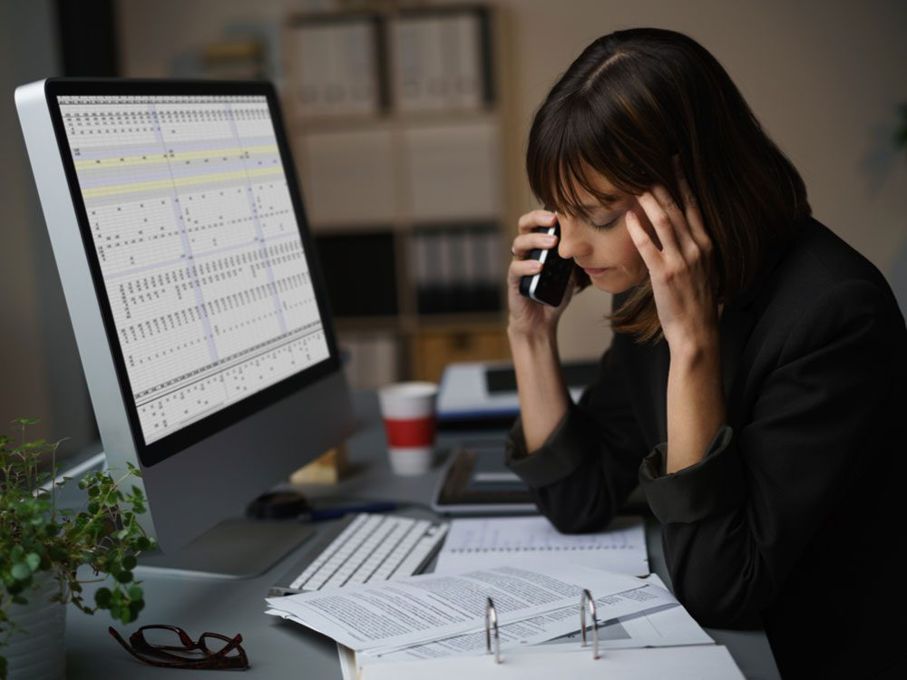 Stressed businesswoman at desk