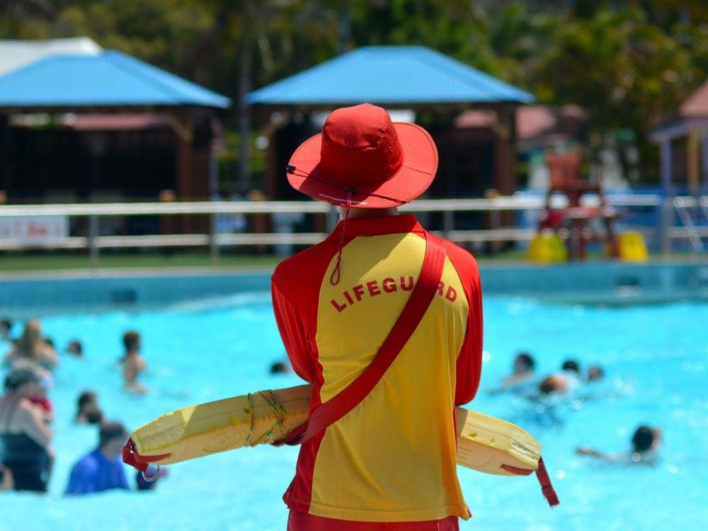 Lifeguard watching public pool