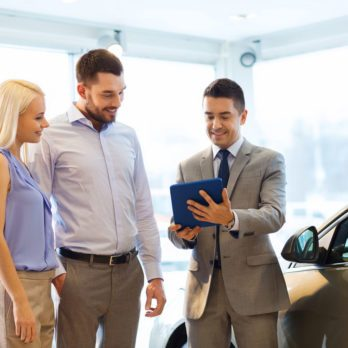 Car dealer with clients