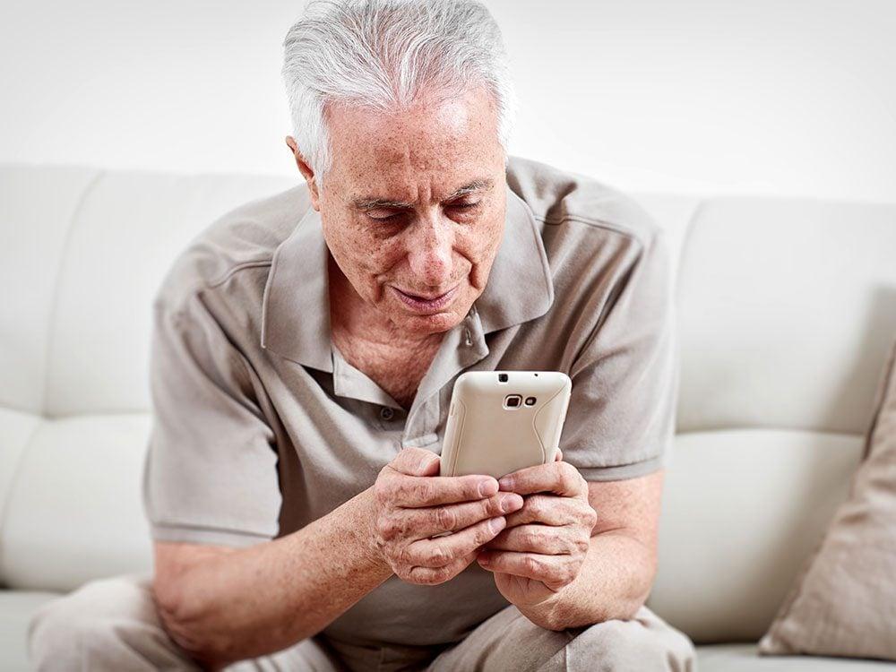 Senior getting a medication reminder via smartphone