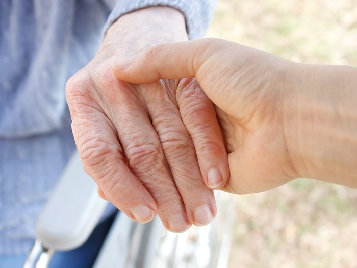 Signs of dementia I missed in my own mother - holding elderly woman's hand