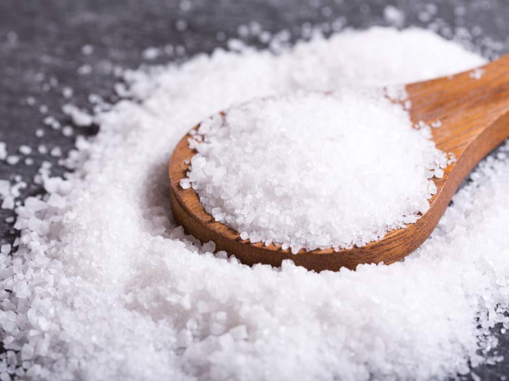 Salt on wooden spoon