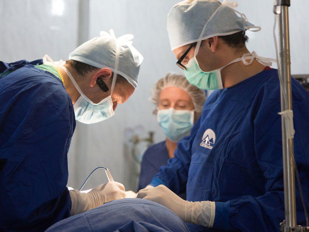 Surgeons performing abdominal surgery