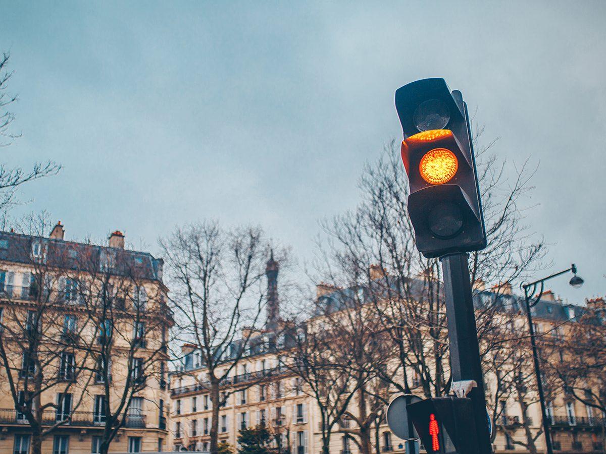 Broken traffic light on a city street - traffic violation