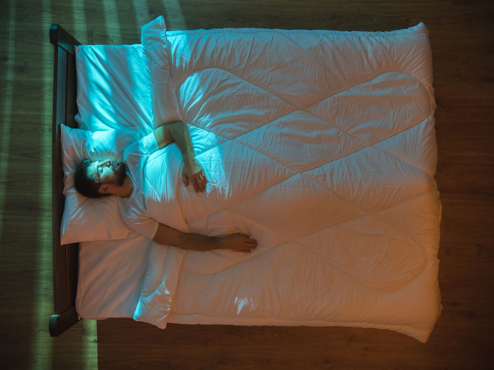 Man asleep with lights on