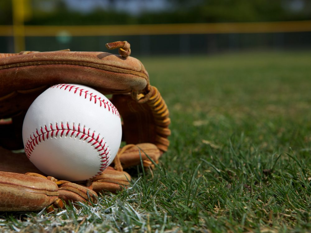 Baseball glove in grass with baseball